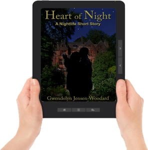 Heart of Night ereader with hands